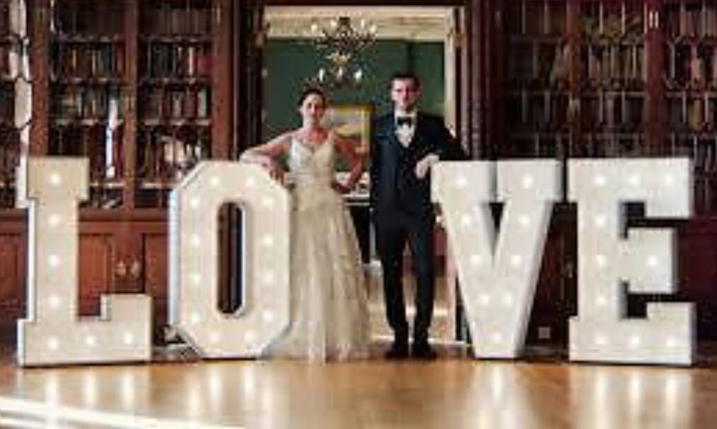 set the tone for your wedding from the second your guests arrive with illuminated love letters